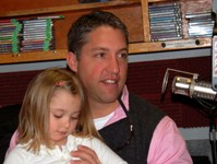 "Jeff Raykes, chief planner, Indiana County Office of Planning and Development, discusses local U.S. Census issues during a March 21, 2010, ""Global Alert"" program segment on the 2010 Census. With Raykes is daughter Adelaide Love Raykes. Photos by David Loomis."