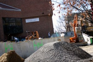 Workers renovate the patio at the entrance to Stapleton Library. Photo by Amber Grady