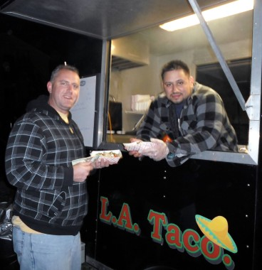 Food vendor Walter F. Aguirre, right, sells tacos to customer Derek Grove, of Indiana, Pa., in a parking lot behind the Phi Kappa Psi fraternity house at 220 S. Seventh Street, Indiana, Nov. 9, 2012. Photo by Colleen O'Laughlin.
