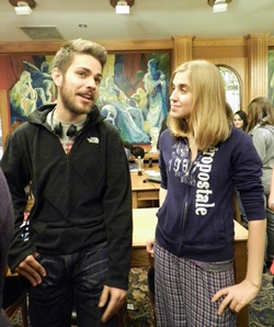 "Whitmyre Hall's head community assistant, Ignacio J. ""Nacho"" Alarcon, talks with community assistant Paige A. Peterson at an Honors College social event on Nov. 29. Photo by Emily Weber."