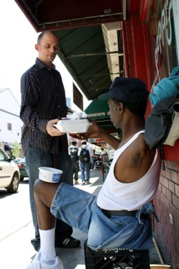"""I hope you like Pepsi,"" says a man who brings Harris a meal of roast chicken and fries.  He invites Harris to an outreach for the hungry called ""The Table,"" held at the Hot Metal Bridge Church on Tuesdays at 5:30 p.m.  ""People are pretty nice out here,"" Harris says.  ""You want some of this?"" he asks."