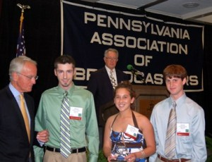 """Global Alert"" producers Mike Wilson, Katherine Caldwell and Garritt Fleming (l. to r.) receive the Pennsylvania Association of Broadcasters award for Outstanding Radio Public Affairs Program in the organization's 2010 Excellence in Broadcasting Competition, Hotel Hershey, May 3, 2010. Photo by David Loomis."