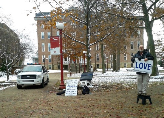 Indiana University of Pennsylvania campus police monitor an unidentified member of a traveling group of evangelical preachers in the Oak Grove in front of Leonard Hall at 2:45 p.m. Tuesday afternoon. Photo by Tia Kordell.