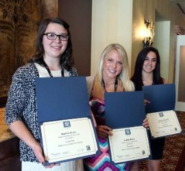 Journalism students Rachel Jones, left; Caitlin Birch, center, and Angela Lupinetti display awards received April 2 in Hershey from the Pennsylvania NewsMedia Association. Photo by Becky Jones.