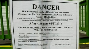 A danger sign issued by Indiana borough officials the afternoon following a floor collapse is posted outside the Oakland Avenue duplex, March 16., 2016. Photo by Logan Huillinger.