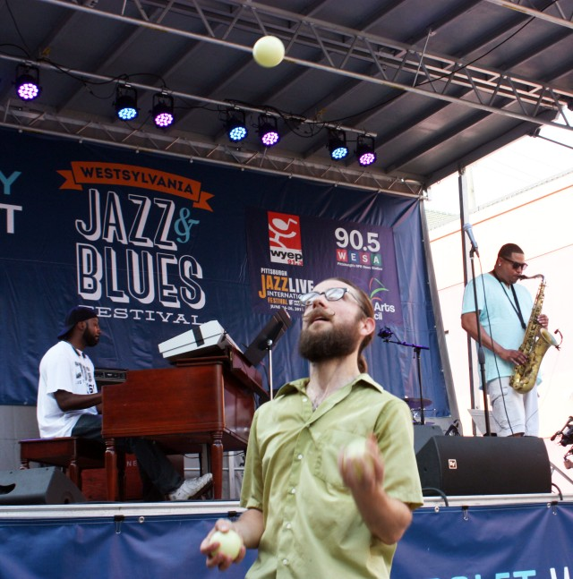 Eric Bonazza, Indiana resident and Brown Hotel employee, juggles as jazz headliners Jevon Rushton and his band perform.