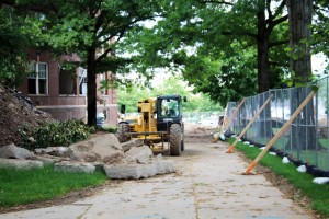 All-terrain forklift moves rubble outside Keith Hall, June 11, 2016.